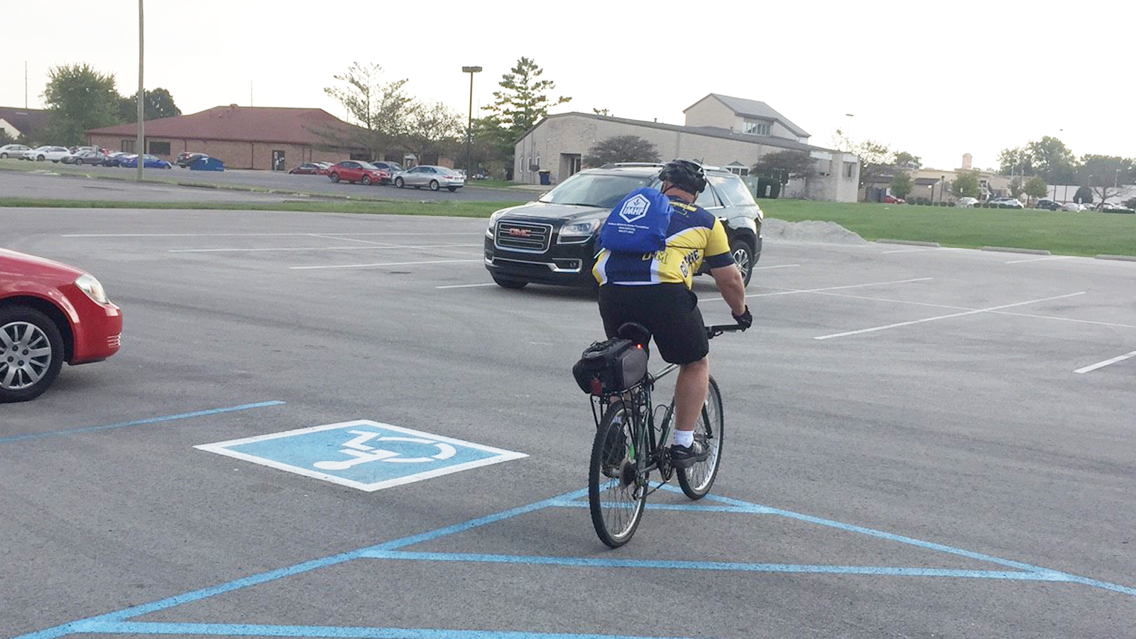 Richy Condre with Bike on Car Free Indy Day 3