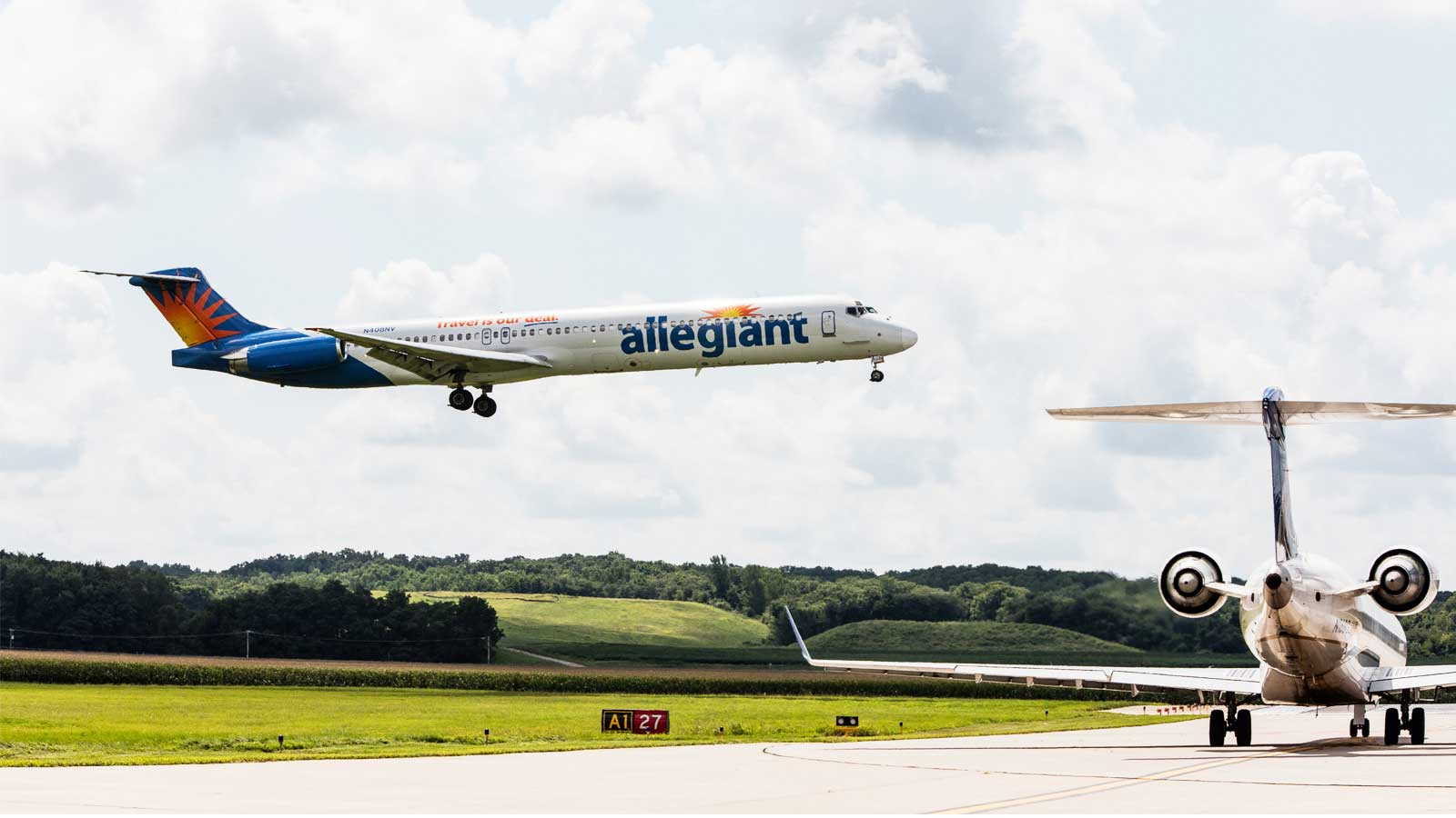 Allegiant plane taking off with other plane on runway